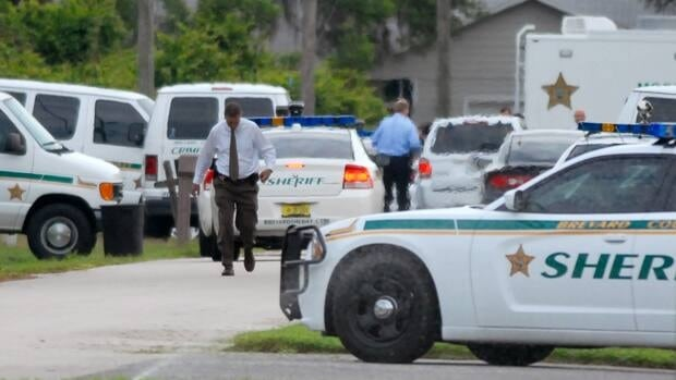 Emergency personel surround the scene of a multiple shooting in Port St. John, Brevard County, Fla., Tuesday, May 15, 2012.
