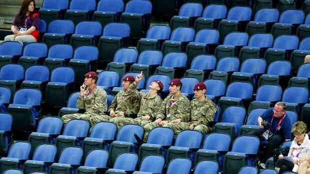 Soldiers sit in seats held by the IOC as they watch the women's gymnastics qualification in the North Greenwich Arena during the London 2012 Olympic Games on Sunday.