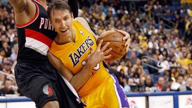 Los Angeles Lakers guard Steve Nash, right, drives around Portland Trail Blazers forward J.J. Hickson during an NBA pre-season game earlier this month.