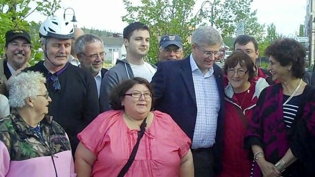 Prime Minister Stephen Harper pauses to meet onlookers in Whitehorse in 2011.