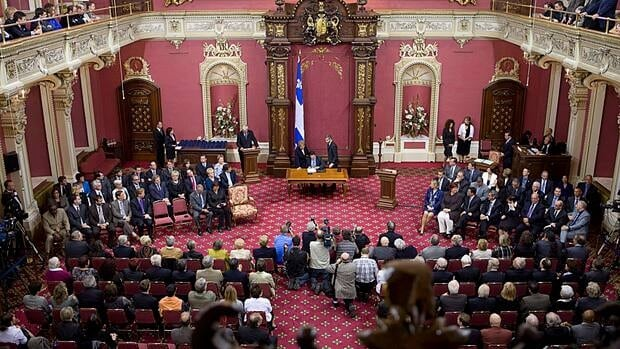 Parti Québécois members are sworn in at Quebec's National Assembly in September. A Canadian flag was removed from the room before the ceremony.