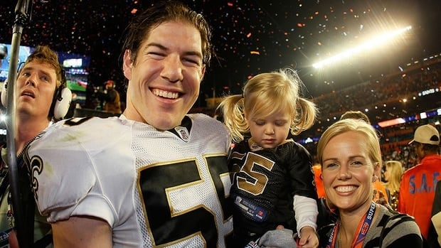 Scott Fujita and his family, seen here celebrating the New Orleans Saints' Super Bowl XLIV victory in 2010, received multiple messages of support from former and current teammates on Twitter after his suspension was overturned.