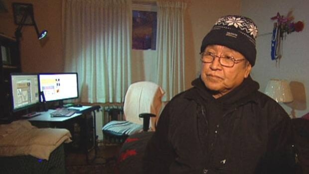 Charles Tizya, who lives at 508 Sherbrook Street, has resorted to wearing long underwear, a jacket and a tuque inside his apartment to stay warm.