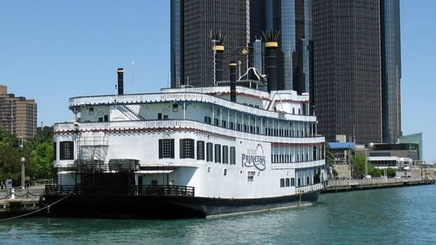 Detroit police say a woman opened fire on a crowd of people  on the city's riverfront, after a fight on board the Detroit Princess river boat.
