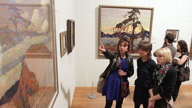 Guests view paintings by Canadian artist Tom Thomson during the show's opening at the Dulwich Picture Gallery in London October 17, 2011.