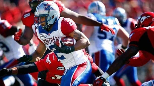 Montreal Alouettes' Brandon Whitaker, left, posted a season-high 115 yards on 18 carries and 64 yards on six receptions for a 179-yard performance in the Als' third win of the season over Winnipeg.
