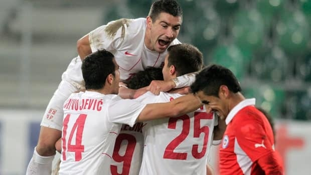 Serbias's players celebrate thier first goal during a friendly soccer match between Serbia and Chile at the AFG Arena in St. Gallen, Switzerland on Wednesday.