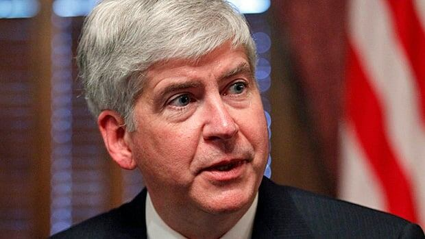 Michigan Gov. Rick Snyder said he was scrutinizing a concealed weapons bill after Friday's massacre at a Connecticut school.