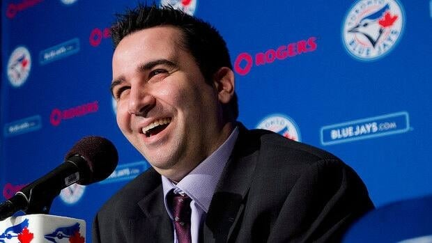 Blue Jays GM Alex Anthopoulos smiles as he discusses the team's 12-player trade with Miami at a news conference on Tuesday.