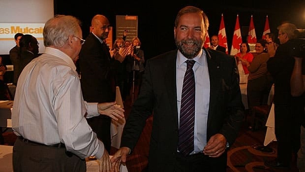 NDP Leader Tom Mulcair is applauded by party supporters after delivering a speech to his caucus at a strategy session in St. John's, N.L., Thursday.