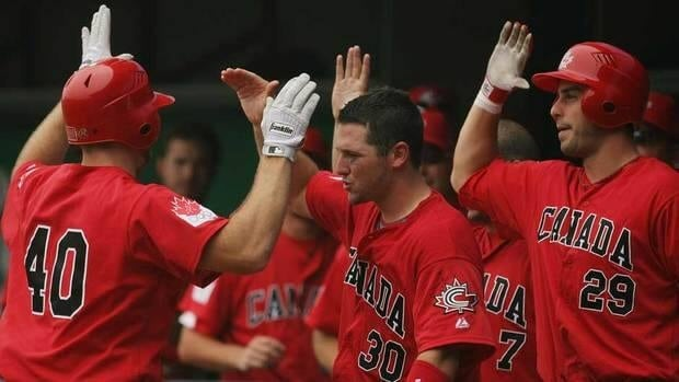 Chris Robinson, centre, shown here during the 2008 Beijing Games, hit a two-run homer to help Canada beat Germany in qualifying for the 2013 World Baseball Classic on Monday.