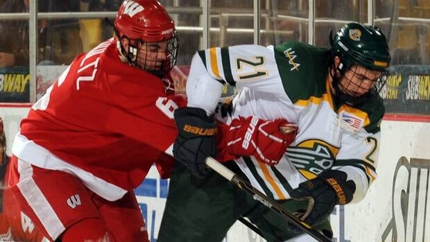 Justin Schultz, seen on the left with Wisconsin in the NCAA, has 16 points so far in AHL play.