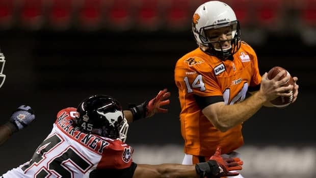 B.C. Lions quarterback Travis Lulay dodges a tackle from Calgary Stampeders' Karl McCartney for a first down in Saturday night's game.