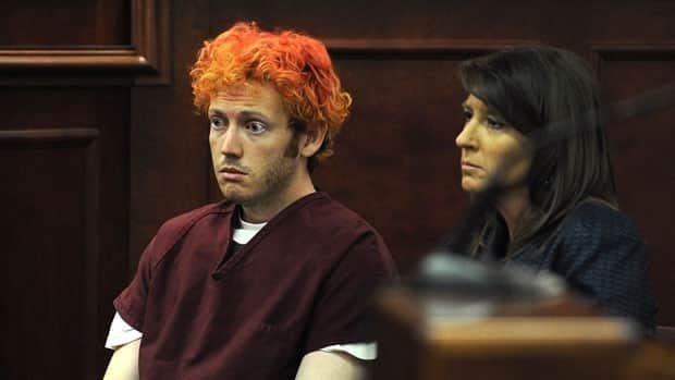 James Holmes (left) sits with public defender Tamara Brady during his first court appearance in Aurora, Colo., last month. He has appeared dazed during his court appearances.