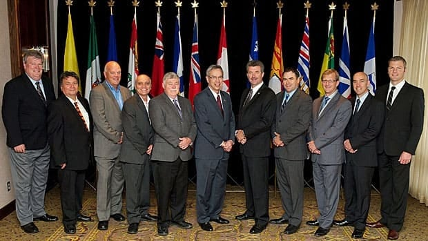 Federal Natural Resources Minister Joe Oliver, centre-left, stands with his provincial counterparts at their annual conference in Charlottetown on Sept. 11.