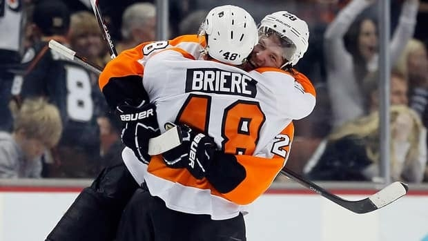 Danny Briere (48) and Claude Giroux (28) will be lacing up their skates in Germany during the NHL lockout.