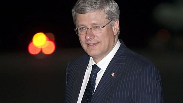 Prime Minister Stephen Harper arrives for the APEC summit in Vladivostok, Russia Friday. APEC leaders will discuss trade and the economy, but it's also an opportunity for Harper to raise other issues with his Russian hosts.