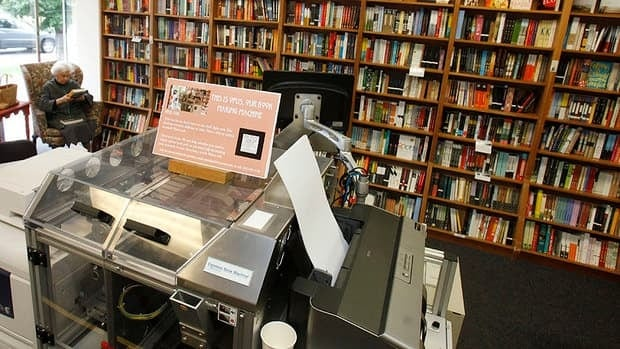 A customer, top left, reads a book printed by the Espresso Book Machine, known as Opus, at the Politics and Prose bookstore in Washington. Self-publishing has been made easier since the machine created by On Demand Books debuted in 2006. The machine can also make copies of out-of-print editions.