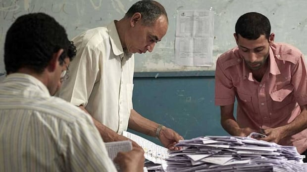 Egyptian election workers count ballots at the end of the two-day presidential election at a school in Cairo Thursday. A run-off will be held between the top two candidates on June 16-17.