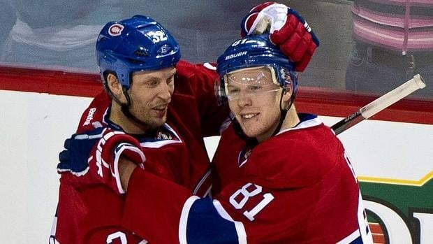 Montreal Canadiens' Lars Eller, right, is congratulated by teammate Travis Moen after scoring a goal against the Winnipeg Jets on Wednesday.