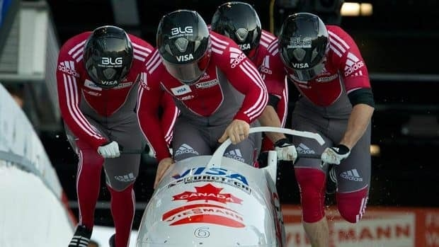 Canada's Lyndon Rush pilots himself along with Jesse Lumsden, Cody Sorensen and Neville Wright during the first run of the four-man bobsleigh at the FIBT World Cup.