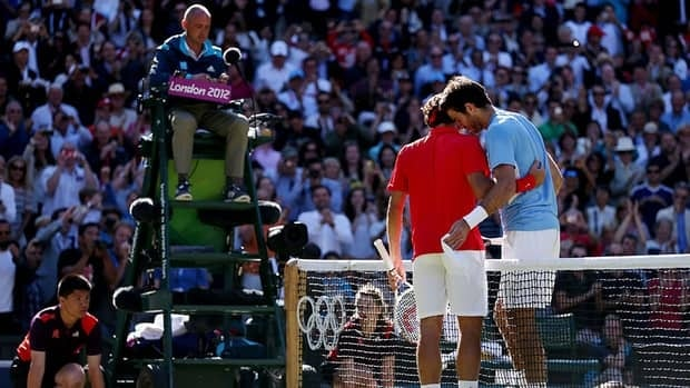 Roger Federer of Switzerland is congratulated by Juan Martin Del Potro of Argentina after his win in the Semifinal of Men's Singles Tennis on Day 7 of the London 2012 Olympic Games at Wimbledon. The marathon match has tennis officials considering rule changes.