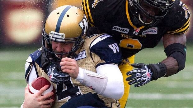 Blue Bombers quarterback Buck Pierce, seen here being tackled by Hamilton's Renauld Williams on Saturday, will miss the team's regular-season finale this weekend against Montreal.
