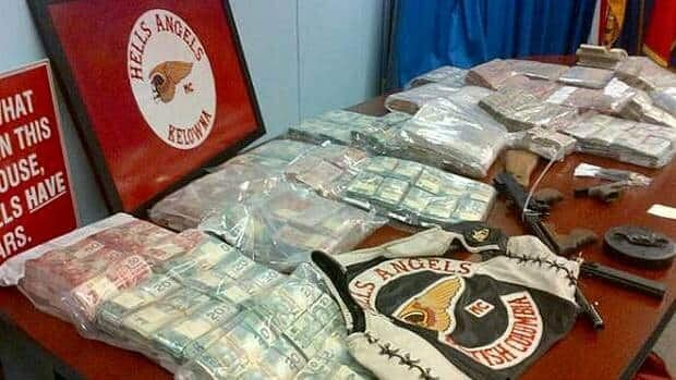 The RCMP show off guns and cash siezed during a weekend raid on the Hells Angels' Kelowna clubhouse.