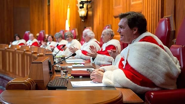 Justice Richard Wagner, right, delivers a speech as his fellow judges take part in his welcoming ceremony at the Supreme Court of Canada in Ottawa Monday.