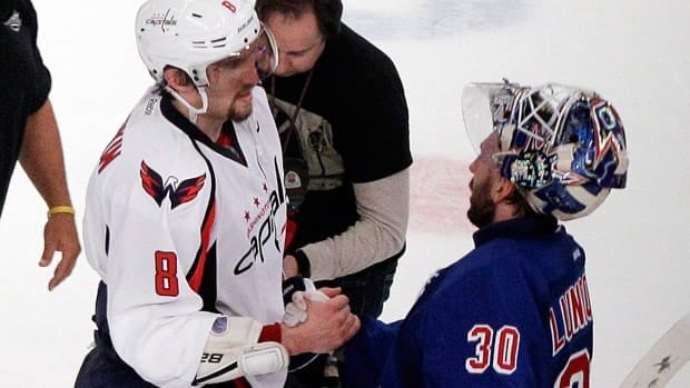 Washington Capitals' Alex Ovechkin (8) and New York Rangers goalie Henrik Lundqvist (30) shake hands after Game 7 on Saturday in New York. The Rangers won the game 2-1.