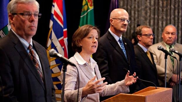 Alberta Premier Alison Redford, seen here with her fellow western premiers in May, has been trying to secure support across Canada for her idea of a Canadian energy strategy.