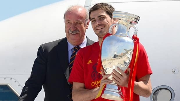 Spain coach Vicente del Bosque, left, stands as captain Iker Casillas holds the Euro 2012 trophy upon the team's arrival at Barajas airport on July 2, 2012, in Madrid.