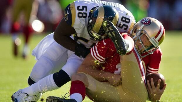 San Francisco 49ers quarterback Alex Smith was hurt on this hit from St. Louis Rams linebacker Jo-Lonn Dunbar in Sunday's NFC West game.