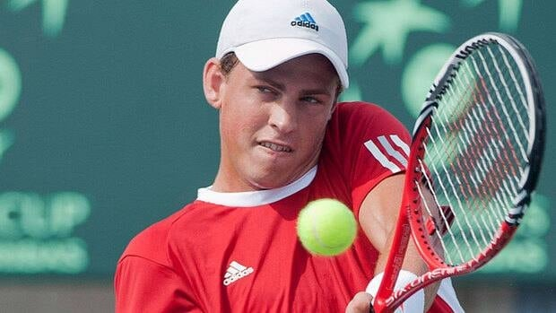 Vasek Pospisil moved on after his opponent retired due to a leg injury.