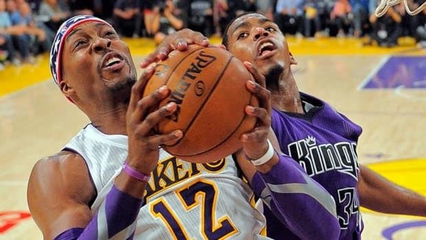 Los Angeles Lakers centre Dwight Howard, seen on the left in Sunday's game, believes the team can benefit from new coach Mike D'Antoni's up-tempo brand of basketball.