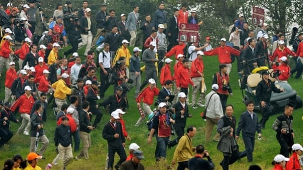 Rory McIlroy and Tiger Woods walk the course in the Duel at Jinsha Lake in China on Monday.