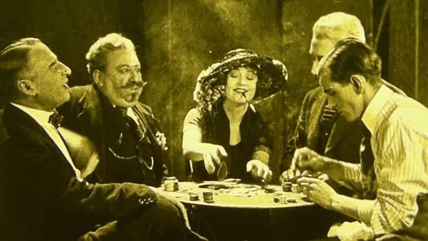 Silent film actress Betty Compson is shown at centre in a scene from the 1924 film The White Shadow, thought to be the earliest surviving work of Alfred Hitchcock.