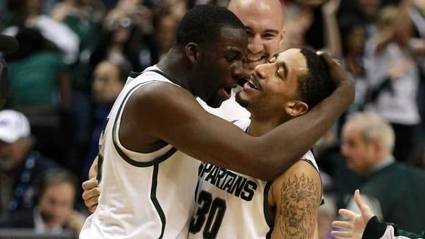 Left to right: Draymond Green and Brandon Wood of the Michigan State Spartans celebrate their win over the Ohio State Buckeyes during the Final Game of the 2012 Big Ten Men's Conference Basketball Tournament on Sunday. Michigan State won that game 68-64, and according to this AP writer, they are the favourites to win the Big Dance.