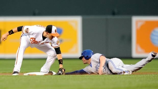 Mike McCoy of the Blue Jays is tagged out by Ryan Flaherty trying to steal second on Aug. 25.