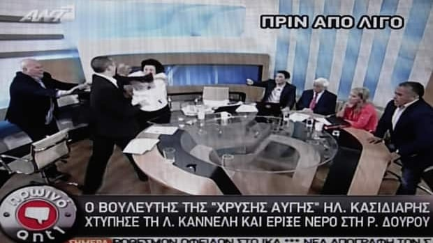In this image taken off a TV screen, Ilias Kasidiaris, spokesman of Greece's far-right Golden Dawn party, slaps Liana Kanelli, a member of the parliament for the Greek Communist Party during a talk show in Athens on Thursday.