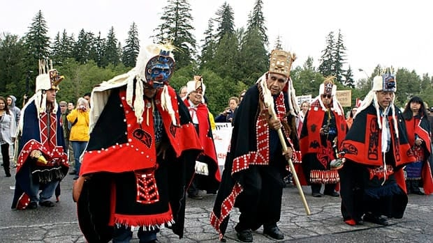 Traditional chiefs from the Heilsuk First Nation in Bella Bella lead a 2010 protest rally outside National Energy Board review panel hearings in Kitimat, B.C. on the proposed Northern Gateway pipeline project. A report from business executives asks the provinces to help bring aboriginal communities to the table for resource development deals.