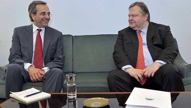 New Democracy leader Antonis Samaras, left, meets with Evangelos Venizelos, the head of the PASOK party, at the Greek parliament in Athens on Monday.