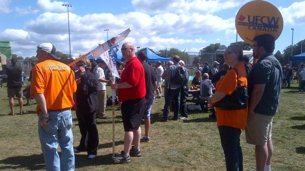 Workers at the Halifax Labour Day rally listen to Labour Minister Marilyn More speak.