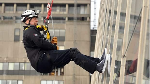 Britain's Prince Andrew abseils down The Shard, the tallest building in Europe, for charity in central London on Monday.