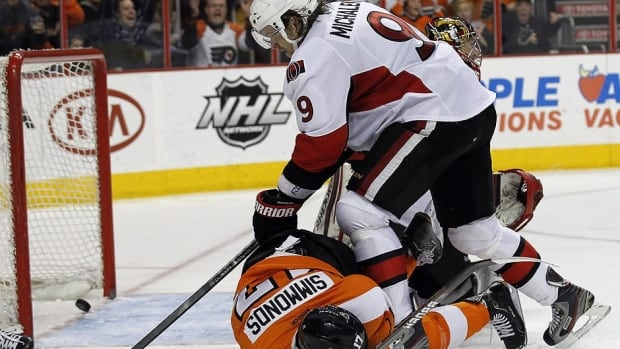Philadelphia forward Wayne Simmonds scored on this play, taking a puck off his face, but it was Milan Michalek and Ottawa holding on for the win.