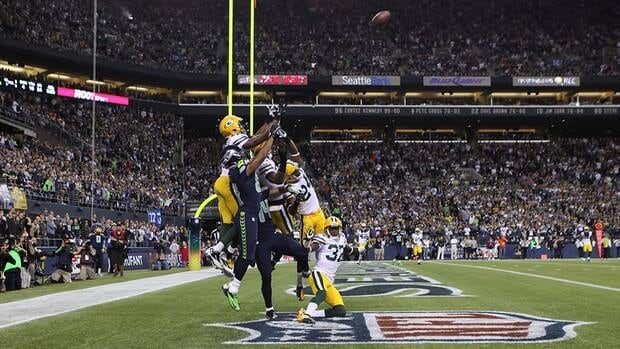 Wide receiver Golden Tate of the Seattle Seahawks makes a catch in the end zone to defeat the Green Bay Packers on a controversial call by the officials at CenturyLink Field on September 24, 2012 in Seattle, Washington.
