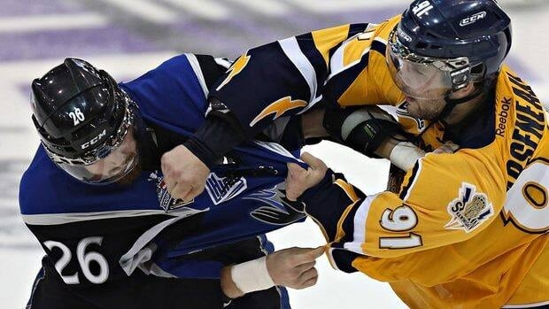 A fight between Memorial Cup participants Grant West, left, of the Saint John Sea Dogs and Shawinigan Cataractes' Vincent Arseneau led to a $2,500 fine for both teams.