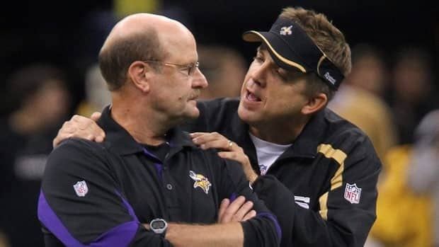 New Orleans Saints coach Sean Payton, right, talks with Minnesota Vikings coach Brad Childress on the field of the Louisiana Superdome prior to an NFL game in September 2010.