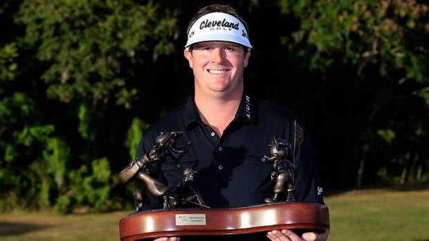 Charlie Beljan poses with the trophy after winning the Children's Miracle Network Hospitals Classic at the Disney Magnolia course on November 11, 2012.