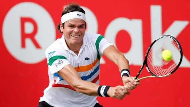 Canada's Milos Raonic returns a shot against Andy Murray of Britain at the men's singles semifinals match at the Japan Open in Tokyo Saturday.